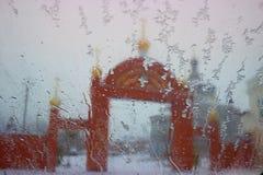Church arch gate. Red bricks church arch gate, winter blur Stock Image