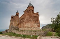 Church of the Archangels and Caucasus mountains in Kakheti. Georgia Royalty Free Stock Photography