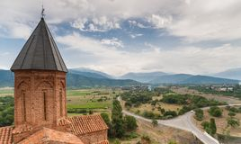 Church of the Archangels and Caucasus mountains in Kakheti. Georgia Stock Photo