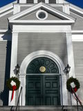 Church: arched entry with wreaths. Church entry with Christmas wreaths in Concord, Massachusetts stock photo