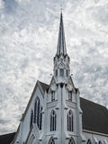 Church architecture and surreal sky. Church steeple, classic church architecture against the clouds stock images