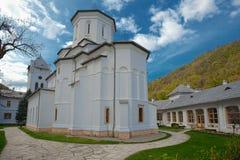 Church architecture in Tismana. Village in Romania Stock Photos