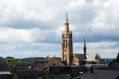 Church of arlon over the roofs of the old town against a cloudy Royalty Free Stock Photos