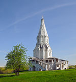 Church of the Ascension in Kolomenskoye Moscow. Church of the Ascension against the blue sky and a tree in the foreground in Kolomenskoye Moscow Stock Image