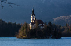 Church of the Assumption Lake Bled Slovenia. St. Martin Church on Island in Lake Bled with Beautiful Mountain Landscape Royalty Free Stock Photography