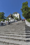 Church Assumption of Mary on lake Bled island. Unrecognized people climb the ancient stone stairs leading to Church of the Assumption of Mary on Lake Bled island Royalty Free Stock Image
