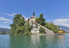 Church Assumption of Mary on lake Bled island. Unrecognized tourists have a rest on stone stairs leading to Church of the Assumption of Mary on Lake Bled island Royalty Free Stock Photos
