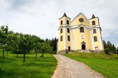 Church of Assumption in sunny mountains, Neratov, Czech republic. Church of Assumption in sunny mountains country, Neratov, Orlicke hory Royalty Free Stock Photography