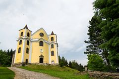 Church of Assumption in sunny mountains, Neratov, Czech republic. Church of Assumption in sunny mountains country, Neratov, Orlicke hory Stock Photography