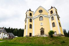 Church of Assumption in sunny mountains, Neratov, Czech republic. Church of Assumption in sunny mountains country, Neratov, Orlicke hory Royalty Free Stock Photo