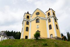 Church of Assumption in sunny mountains, Neratov, Czech republic. Church of Assumption in sunny mountains country, Neratov, Orlicke hory Stock Photos