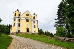 Church of Assumption in sunny mountains, Neratov, Czech republic. Church of Assumption in sunny mountains country, Neratov, Orlicke hory Stock Image