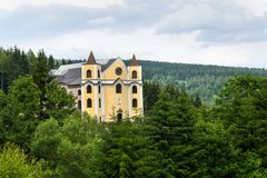 Church of Assumption in sunny mountains, Neratov, Czech republic. Church of Assumption in sunny mountains country, Neratov, Orlicke hory Royalty Free Stock Photos