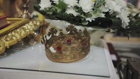 Two crowns for wedding ceremony in the Church. Church attributes for wedding ceremony. Gold crowns are on the altar. Attributes of priest. Interior of church stock video