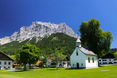 Church in Ehrwald village Austria view of Germany highest mountain Zugspitze Alps. Traveling Europe and austrian alps Stock Photo