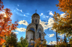 Church in the autumn forest Stock Photos