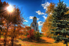 Church in the autumn forest Stock Images