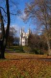 Church in the autumn park Stock Photo