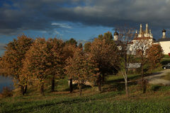 Church among autumn trees Royalty Free Stock Image