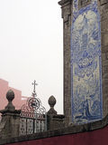Church Azulejos Porto. Small earthenware tiles painted and hand-decorated, the Azulejos is an ancient art in Portugal. It serves as decoration (inside and Stock Photo