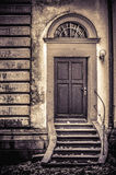 Church backdoor artwork. Interesting church backdoor artwork in sepia royalty free stock image