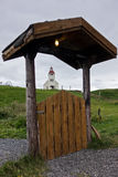 Church in background of Modrudalur farm entrance gate, Iceland Stock Images