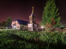 The Church on the background of the starry sky. The architecture of Orthodox churches and monasteries characterized by originality and expressiveness. Night Stock Photo