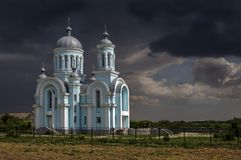 The Church on the background of a stormy sky. Ukraine.Kherson region.The Church on the background of a stormy sky royalty free stock photo
