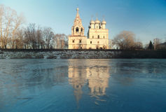 Church on the banks of the frozen river Royalty Free Stock Images