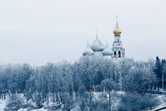 Church on the banks of the frozen river Stock Image