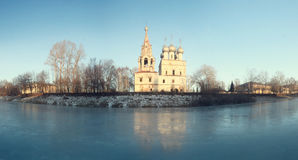 Church on the banks of the frozen river Royalty Free Stock Image