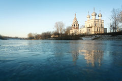 Church on the banks of the frozen Stock Photos