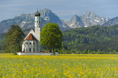 Church in bavaria. Landmark church St. Coloman at alps mountains in Bavaria, Germany, at springtime Stock Images