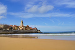 Church with beach and sea 1. Typical Asturian church with blue sky, beach, sunlight and sea Royalty Free Stock Images