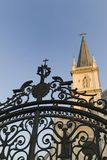 Church behind Gate. Gothic chapel and wrought iron gate royalty free stock photos