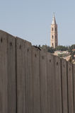 Church behind Israeli separation wall Royalty Free Stock Photos