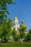 Church behind trees Stock Photo