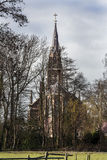 Church behind trees Royalty Free Stock Images