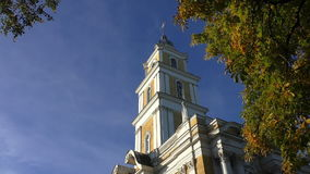 Church belfry and chestnut tree in autumn stock video