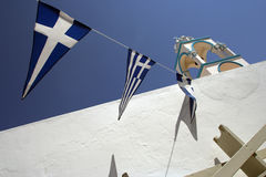 Church belfry and flags in Greece Stock Photos