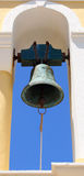 Church bell. Bronze bell on greek orthodox church open tower with blue sky on background Royalty Free Stock Photos