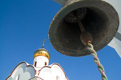Church and bell. Bell and church on the sky background Stock Images