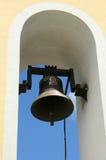 Church bell. Under an arch Stock Photos