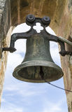 Church bell. Ancient church bell supported by an arcade stone wall Royalty Free Stock Images