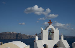 Church bell in Ia, Santorini, Greece. Looking toward Fira town Royalty Free Stock Photography