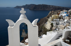 Church bell in Ia, Santorini, Greece. Overlooking the sea to Therisia Stock Image