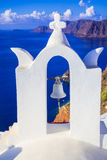 Church bell in Oia village, Santorini island, Cyclades, Greece. White blue contrasts Royalty Free Stock Photo