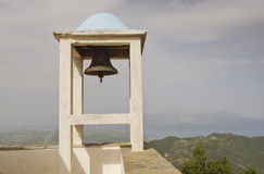 Church bell overlooking misty islands Royalty Free Stock Photo