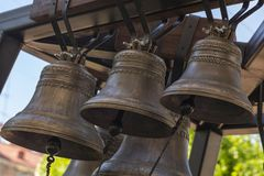 Free Church Bell. Several Metal Church Bells. Bell Ringing. Selective Focus Royalty Free Stock Photo - 150480455