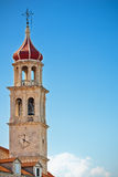 Church bell tower. Parish church of holy Marie bell tower with clock in Sutivan on island Brac, Croatia Stock Image